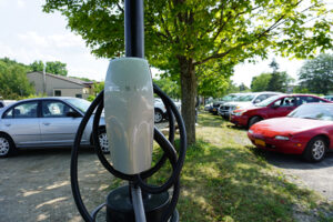 Electric vehicle charging station installed in school parking lot.