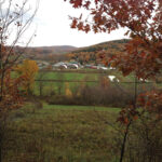 view of Hawthorne Valley Farm from West Hill in autumn