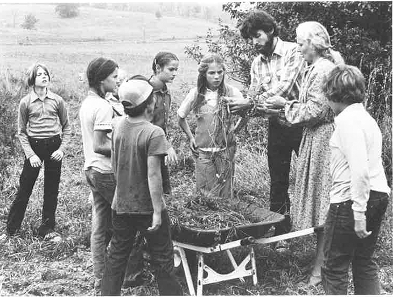 historic photo of children learning about gardening and soil